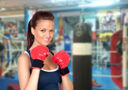 Attractive girl practicing boxing in the gym photo