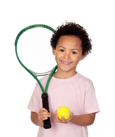 Happy latin child with a tennis racket isolated on white background