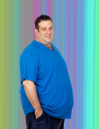 Happy fat man with a colorful background photo