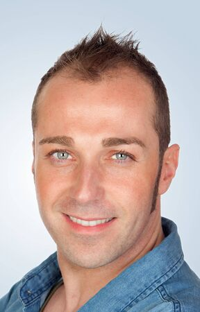 sympathetic: Sympathetic man smiling isolated on blue background Stock Photo