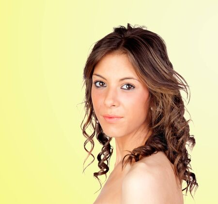 Beautiful girl isolated on a over yellow background photo