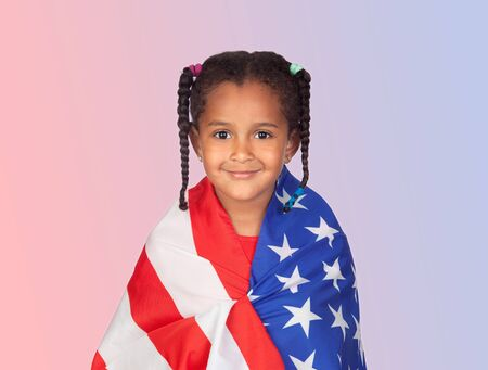 Afro-American girl with a American flag isolated on a blue and red background photo