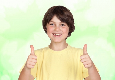 accepting: Funny portrait of freckled boy accepting isolated on a green background