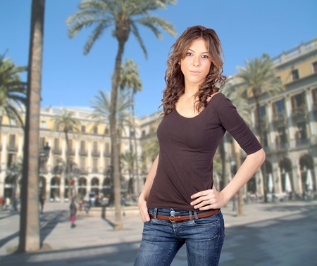 Sexy girl walking in the city with palm-trees photo