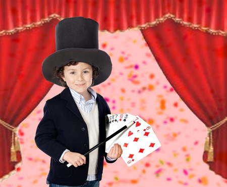 Young magician doing a card trick in a theater photo