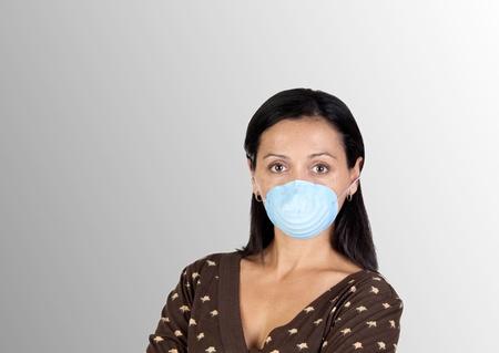 immunize: Brunette girl with mask isolated over grey