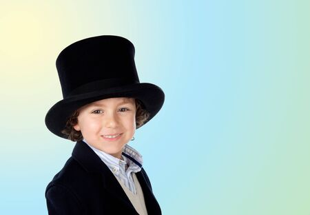 tophat: Adorable child with a black top-hat isolated on a over blue and yellow background Stock Photo