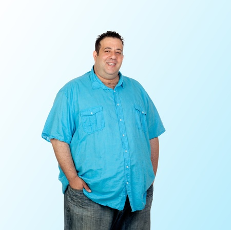 Happy fat man with blue shirt isolated on blue background