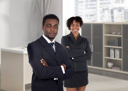 african businessman: Couple of young african executives in the office Stock Photo