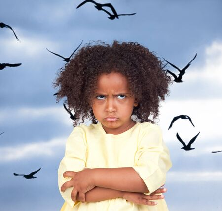 angry child: Angry little girl with beautiful hairstyle and many birds flying