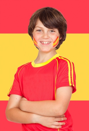 Spanish boy with t-shirt team and Spain flag of background photo