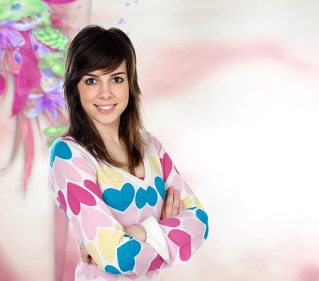 likeable: Attractive young casual girl with a pink and flowered background Stock Photo