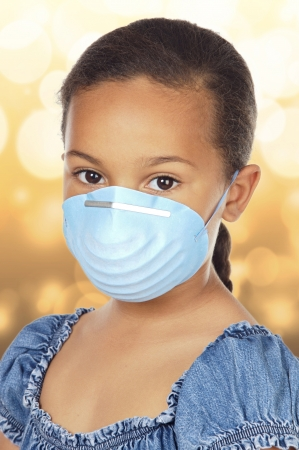 dust mask: Close-up Of Little Girl Wearing Protective Mask  Stock Photo