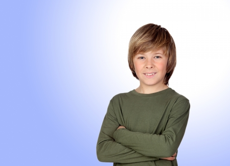Portrait of adorable child with crossed arm isolated on a over blue background Stock Photo - 18293852