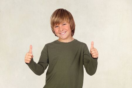 Adorable child saying OK on a over brown background Stock Photo - 18293857