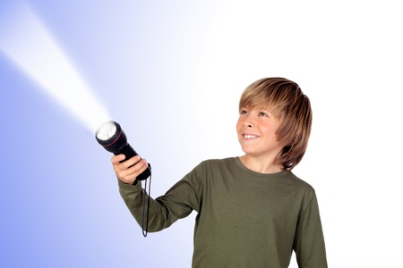 iluminate: Child with a flashlight looking for something on blue background