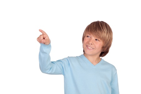 Happy preteen boy pointing something isolated on a over white background photo