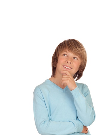 Pensive preteen boy isolated on a over white background photo