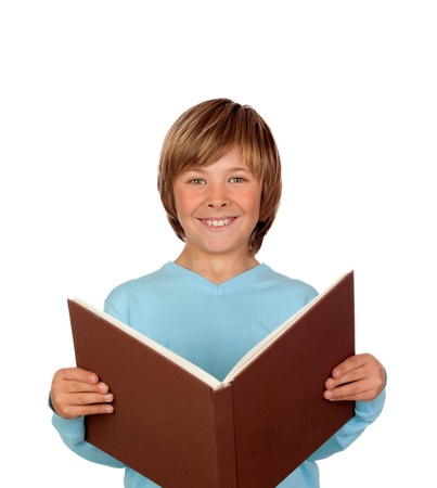 big smile: Preteen boy with a big book reading isolated on white background