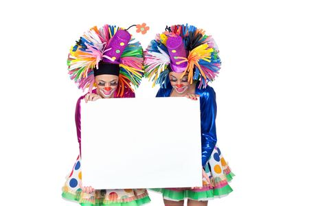 Couple of funny clowns with a blank poster isolated on white background photo