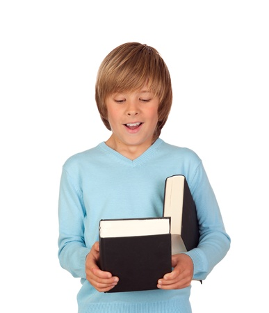 Surprised preteen boy with a book isolated on a white background Stock Photo - 18522254