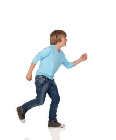 Profile of adorable preteen boy walking isolated on a over white background photo