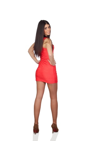 Brunette girl with a red dress isolated on white background photo