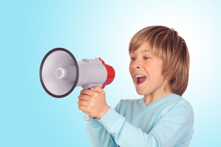 divulge: Portrait of adorable child with a megaphone isolated on a over blue background Stock Photo