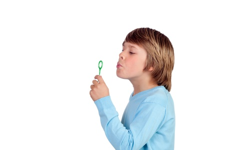 blowing bubbles: Adorable preteen boy blowing for make bubbles isolated on a over white background