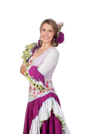 Spanish girl dressed in traditional costume Andalusian isolated on white background photo