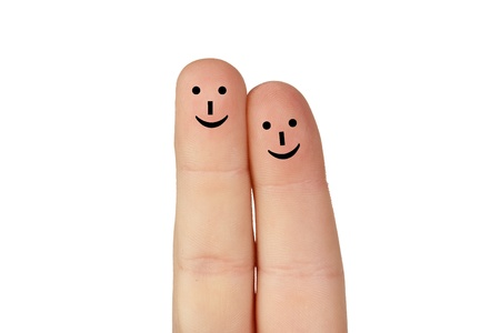 Couple of fingers together and happy isolated on white background photo