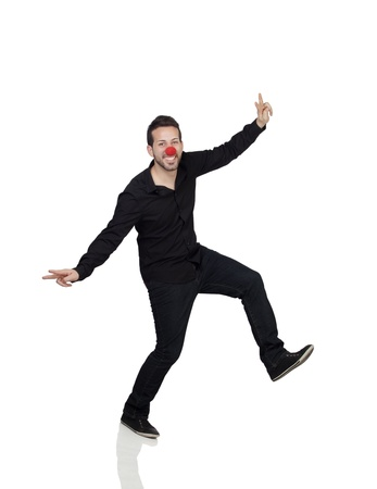 silliness: Young Man Dancing With Clown Nose Over White Background Stock Photo