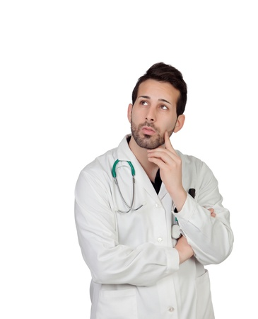 Pensive young doctor isolated on a over white background