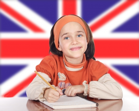 Cute Happy Girl Studying In Front Of British Flag Stock Photo