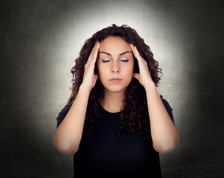 aching: Young Woman With Severe Headache Holding Forehead In Pain