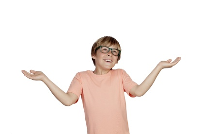 ooking: Smiling boy with a doubtful expression isolated on a white background Stock Photo