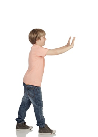 Boy pushing something isolated on white background photo