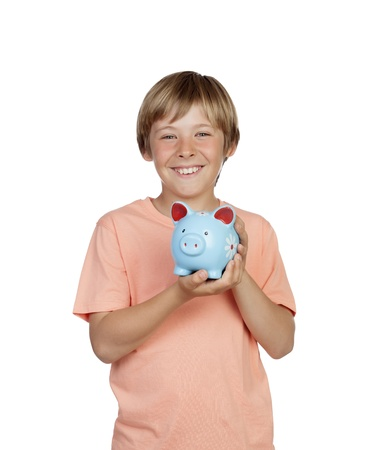Smiling boy holding a blue piggy-bank isolated on a over white background photo