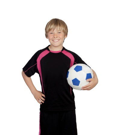 Preteen with a uniform for play soccer holding a ball isolated on white background photo