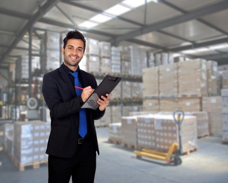 Young businessman with a clipboard in his workplace Stock Photo