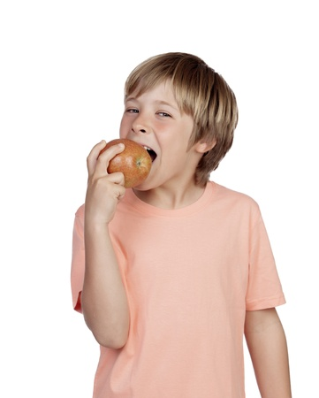 Preteen eating a red apple isolated on white background photo