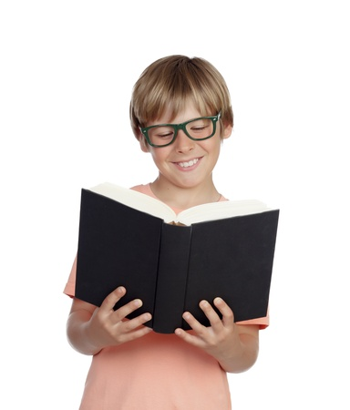 Preteen boy reading a book with glasses isolated on white background photo