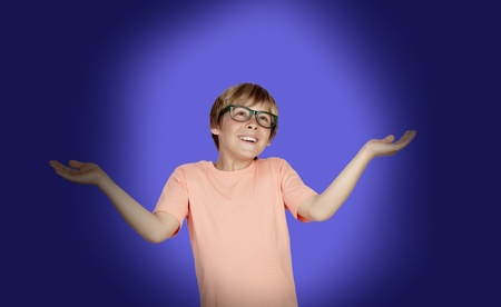 сooking: Smiling boy with a doubtful expression on a over blue background