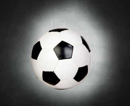 Soccer ball on a gray irregular background  photo