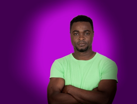 Atractive african-american men on purple background photo