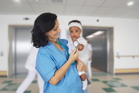 Brunette pediatrician at the hospital with a beautiful baby photo