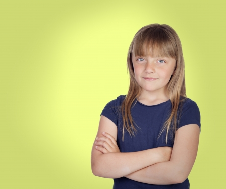 Adorable girl with blond hair on a over yellow background photo