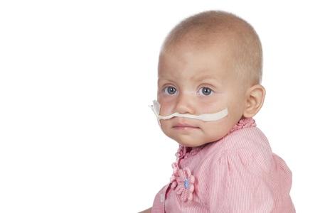 leukemia: Adorable baby beating the disease isolated on white background