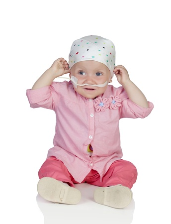 Adorable baby with a headscarf beating the disease photo