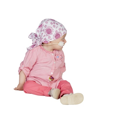 Adorable baby with a headscarf beating the disease isolated on white background photo